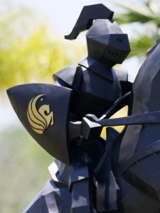 University of Central Florida logo with Knight in armour riding horse