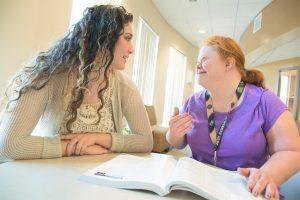 Resource Facilitator & Student discussing homework